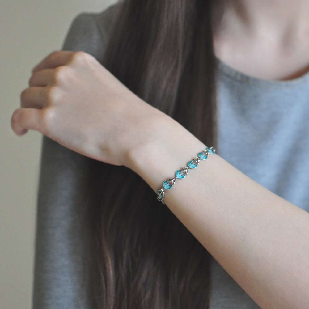 9 31e - Браслет из серебра «Голубки»